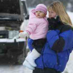 Lady and child broken down in the snow - DSL Tuition Driving School